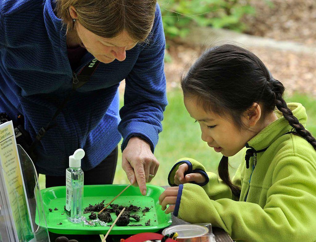 Volunteer and child at SlugFest