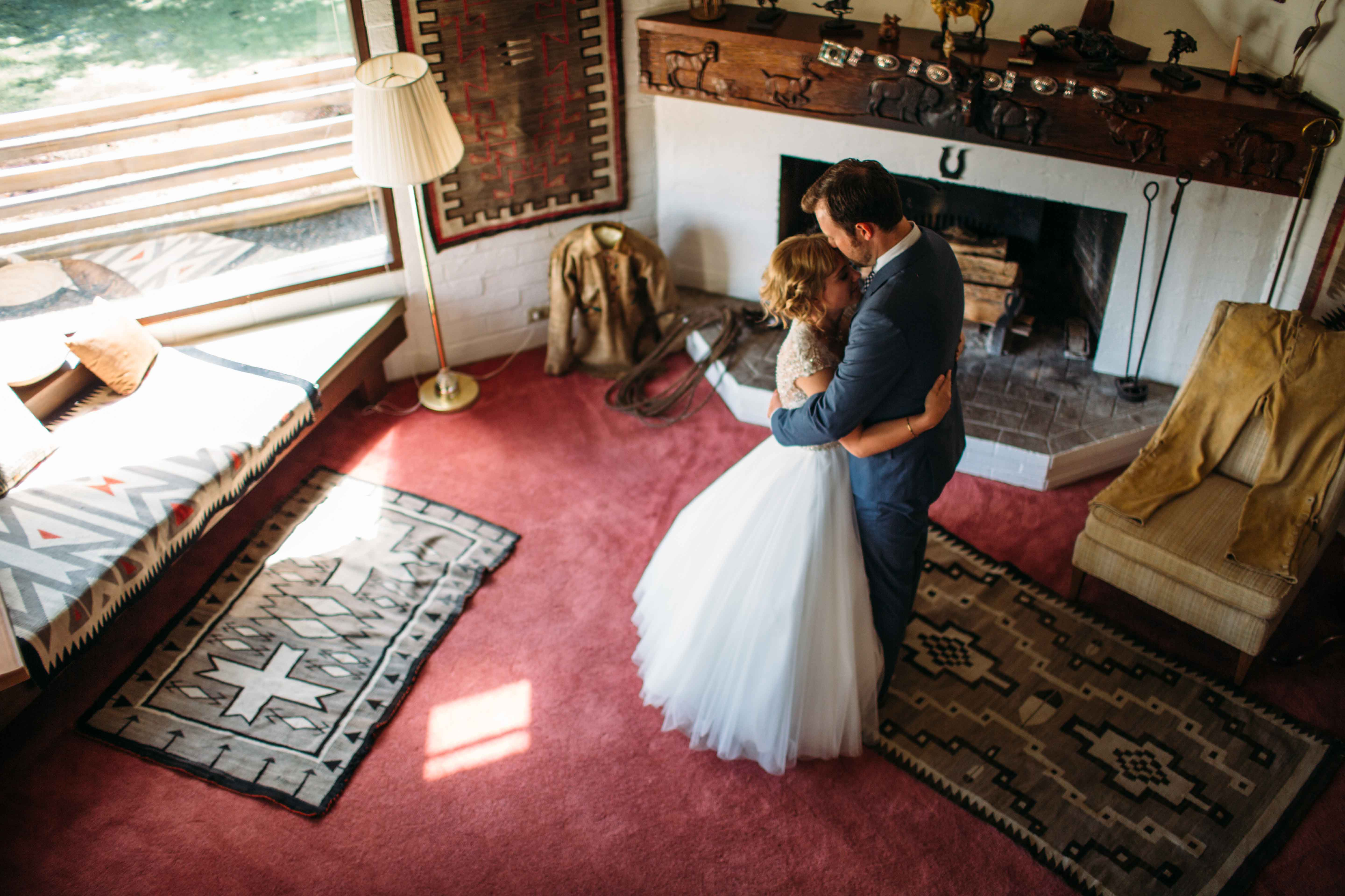 Wedding couple by fireplace