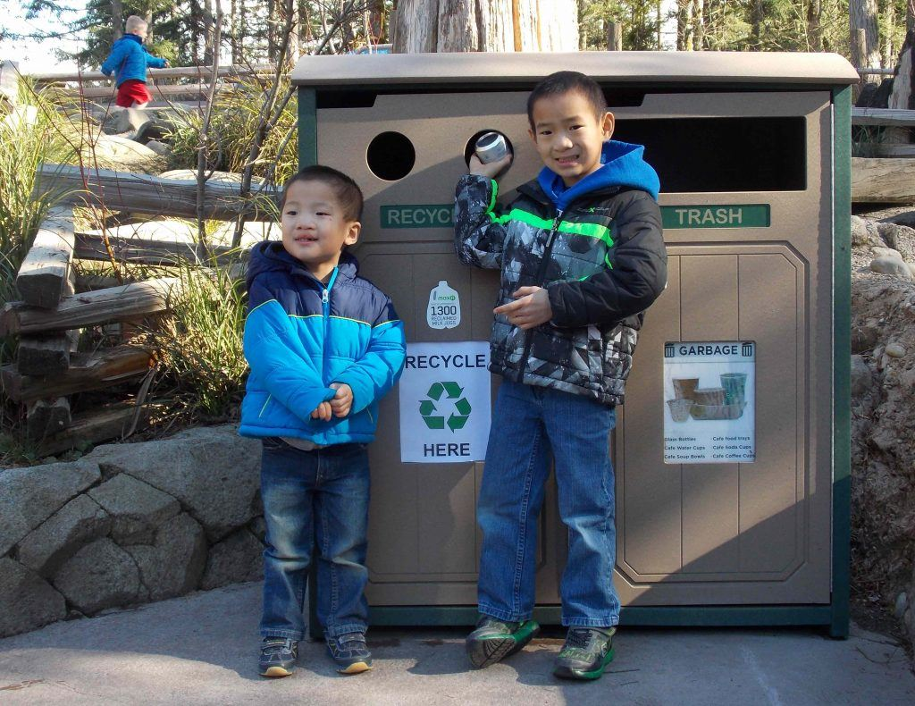 Two kids recycling at Northwest Trek